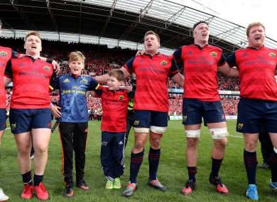 Tony and Dan Foley sing with the Munster players after the game.