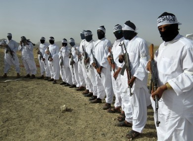 File: Taliban suicide bombers stand guard during a gathering of a breakaway Taliban faction.