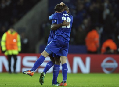 Wes Morgan and Leicester's Christian Fuchs celebrate after winning the Champions League Group G soccer match between Leicester City and Club Brugge.