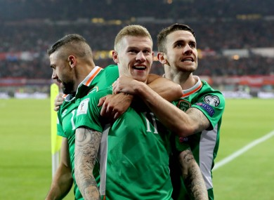 McClean is hugged by Brady and Walters after his goal.