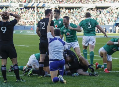 Ireland's Rob Kearney, centre, signals as his team scores against New Zealand.