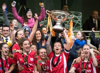 Shelbourne Ladies' Pearl Slattery lifts the trophy.