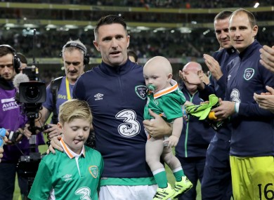 Keane with sons Robert and Hudson after his final game for Ireland.