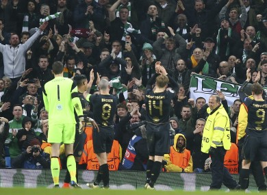 Celtic players celebrate with fans last night.