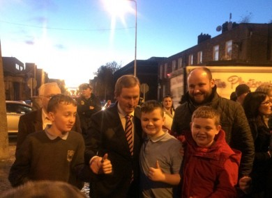 The Taoiseach poses for photos with locals from the north inner city.