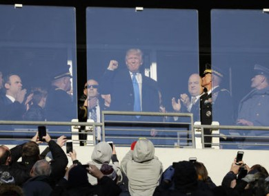 Trump acknowledges spectators during the first half of the Army-Navy NCAA college football game in Baltimore yesterday.