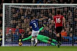 Substitute Fellaini concedes late penalty as Man United throw away all three points