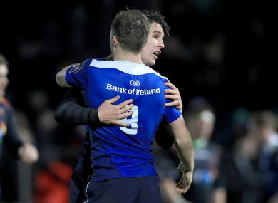 Luke McGrath and Joey Carbery celebrate Leinster's fourth try.
