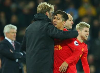 Liverpool manager Jurgen Klopp and Roberto Firmino.