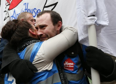 Activists hug each other this morning outside Apollo House.