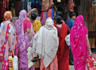Women in saris, traditional Indian dress.