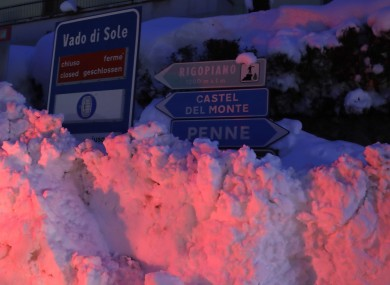 A sign for the Hotel Rigopiano, almost completely covered in snow following the avalanche