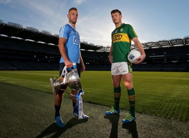 Champions and pretenders - Dublin's Jonny Cooper with Kerry star Donnchadh Walsh.