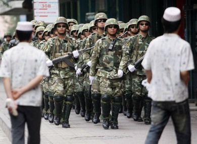 File photo of police in Xinjiang province.