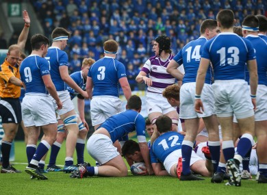 David Jeffares goes over for Clongowes' first try.