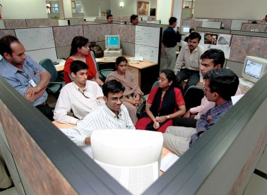 Professionals at a training session in Infosys in Bangalore - India is a training ground for one of the world's largest technology work forces.
