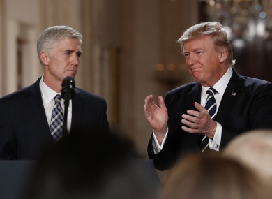 Trump applauds new Supreme Court judge Neil Gorsuch in the White House yesterday.
