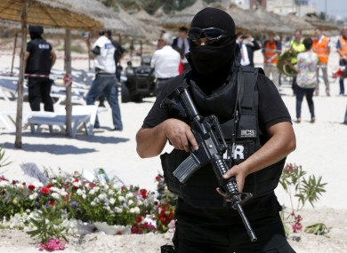 A policeman stands guard at the scene of the terrorist attack a few days after 38 people were killed