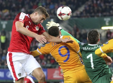 Austria's Stefan Ilsanker batttes Eugeniu Cebotaru, Stanislav Namasco and Alexandru Gatacan for the ball.