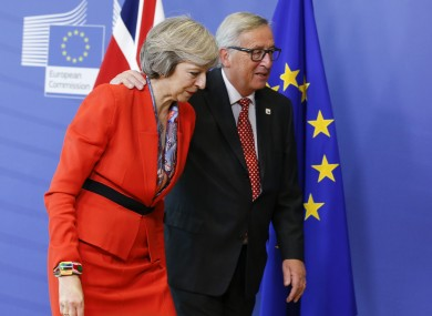 Juncker with Theresa May at a meeting in October.