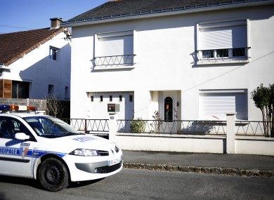 This file photo shows a police car parked outside the house belonging to the missing Troadec family in Orvault, near Nantes, western France.