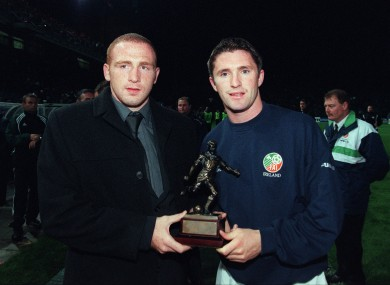 Robbie Keane presents Glen Crowe of Bohemians with his League of Ireland player of the month award in October 2000.