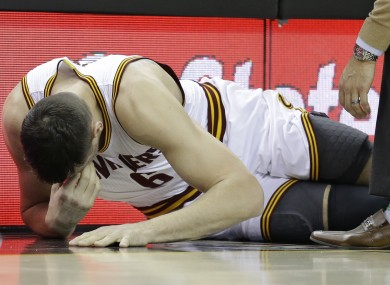 Bogut lies on the court in pain.