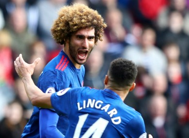 Marouane Fellaini celebrates with Jesse Lingard.