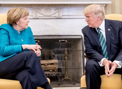 German chancellor Angela Merkel sits next to US president Donald Trump before their meeting in the oval office in Washington on Friday.