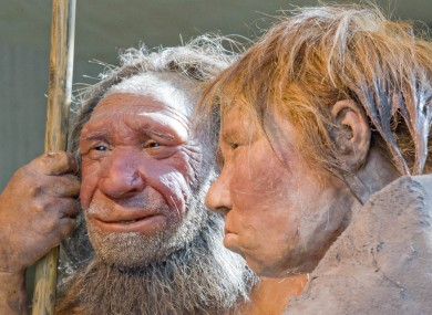Reconstructions of a Neanderthal man and woman.