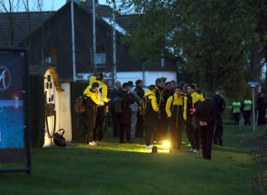 The Dortmund players waiting around after last night's incident.