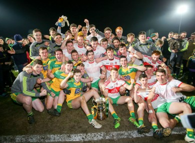 The Donegal players with their trophy.