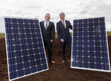 Mike Quinn, CEO of Bord na Móna, and Pat O'Doherty, ESB Chief Executive, with some of the solar panels