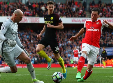 Gary Neville has criticised Mesut Ozil's performance against Man City.
