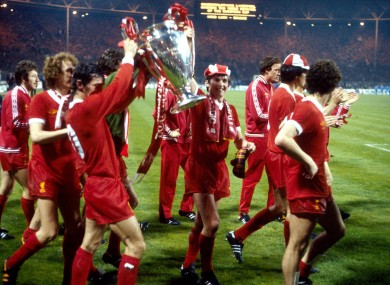 Liverpool's Terry McDermott (third l) and Kenny Dalglish (fourth r) celebrate with the European Cup.