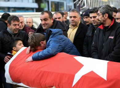 Family members and friends mourn as they attend funeral prayers for one of the victims of the attack in January.