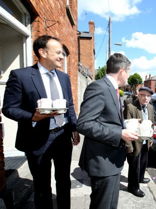 Leo Varadkar and Paschal Donohoe arrive on Leo Street this morning with coffee for the assembled press.