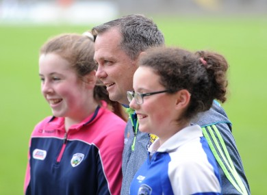 Davy Fitzgerald poses with young fans at O'Moore Park on Sunday.