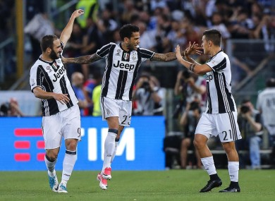 Juventus' Dani Alves (centre) celebrates with his teammates Paulo Dybala, right, and Gonzalo Higuain.
