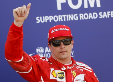 Ferrari driver Kimi Raikkonen of Finland greets the crowd.