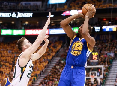 Golden State Warriors forward Kevin Durant (35) shoots the ball over Utah Jazz forward Gordon Hayward (20) during the second quarter in game three.