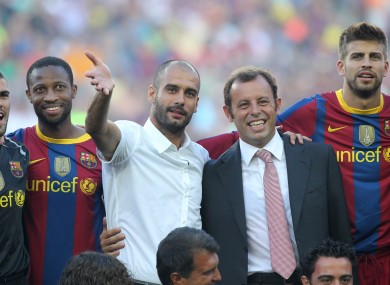 Rosell poses with Pep Guardiola ahead of a pre-season fixture in 2010.
