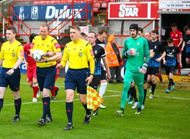 The Athlone players walk out alongside Shelbourne at Tolka Park earlier this season.