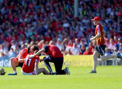 Conor Lehane is treated by the Cork medical staff.