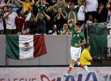 Mexico's Raul Jimenez celebrates after scoring a penalty kick.