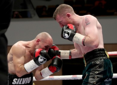 Paddy Barnes punches Silvio Olteanu.