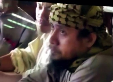 The purported leader of the Islamic State group's Southeast Asia branch, Isnilon Hapilon, at a meeting of militants at an undisclosed location.