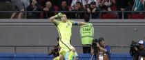 Claudio Bravo celebrates winning the Confederations Cup semi-final.