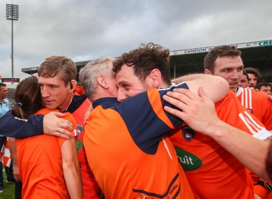 Armagh players and management celebrate the win over Tipperary.