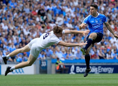 Kildare's Kevin Feely tries to block down Dublin's Bernard Brogan.